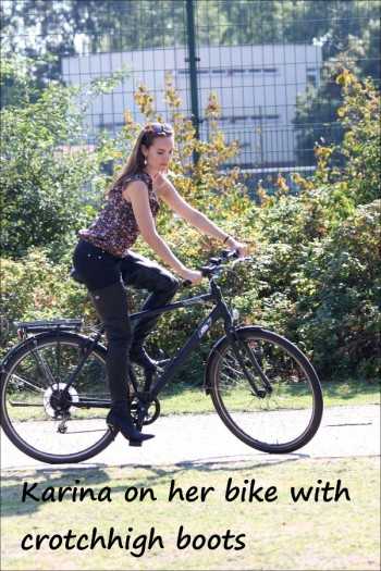 Karina on her bike with crotchhigh boots